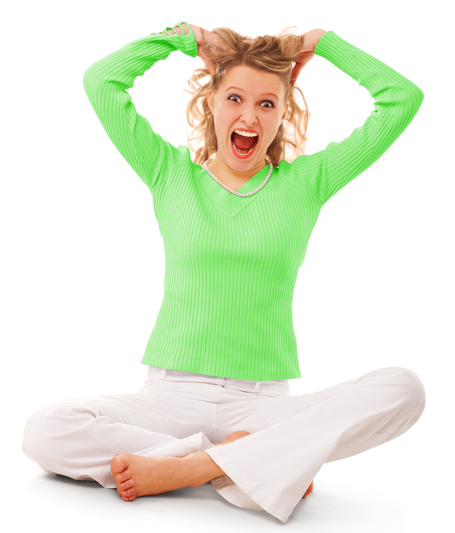 Screaming woman in green seated on floor on white background