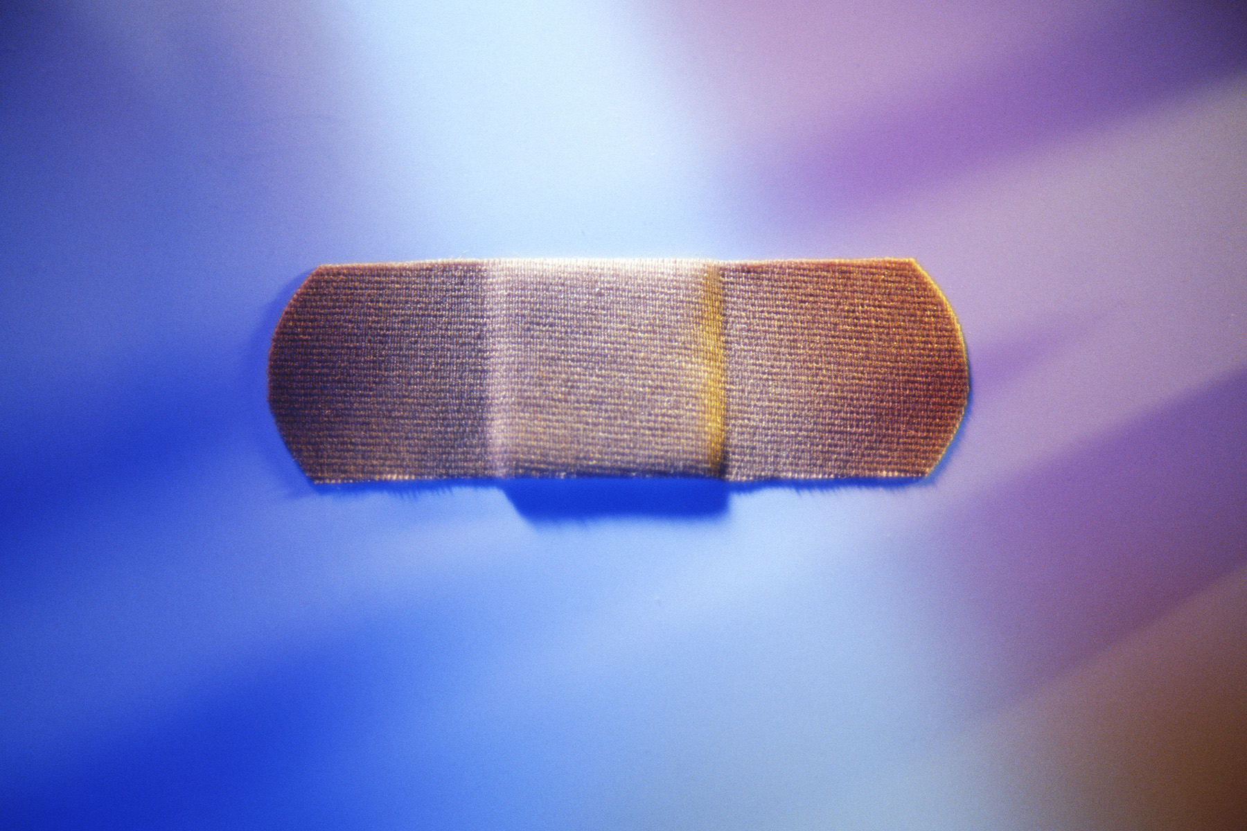 Band aid with blue and purple lighting