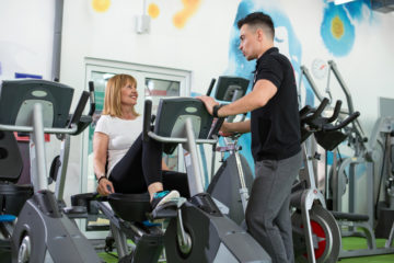 Motivation for good exercise, personal trainer with client