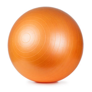 Close up of an orange fitness ball isolated on white background
